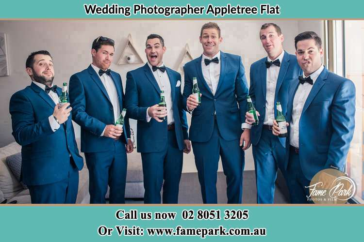 The groom and his groomsmen striking a wacky pose in front of the camera Appletree Flat NSW 2330