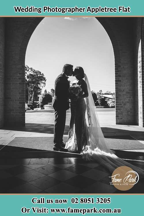 Photo of the Groom and the Bride kissing Appletree Flat NSW 2330