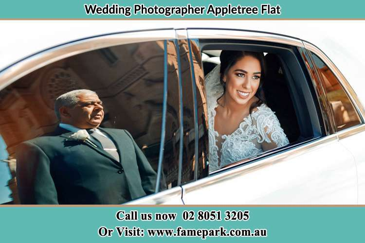 Photo of the Bride inside the bridal car with her father standing outside Appletree Flat NSW 2330