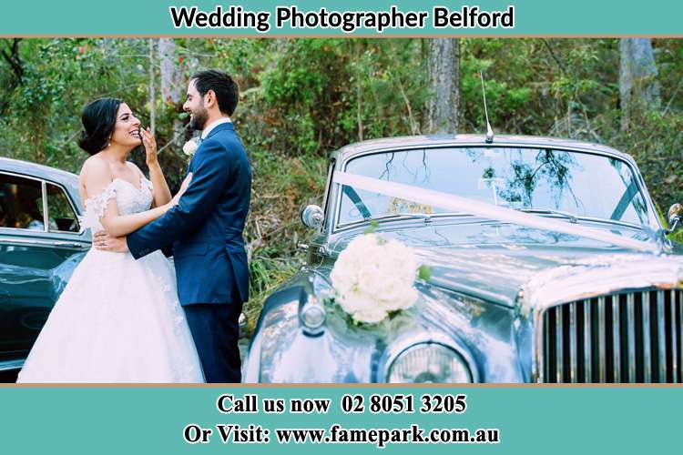 Photo of the Bride and the Groom near the bridal car Belford NSW 2335