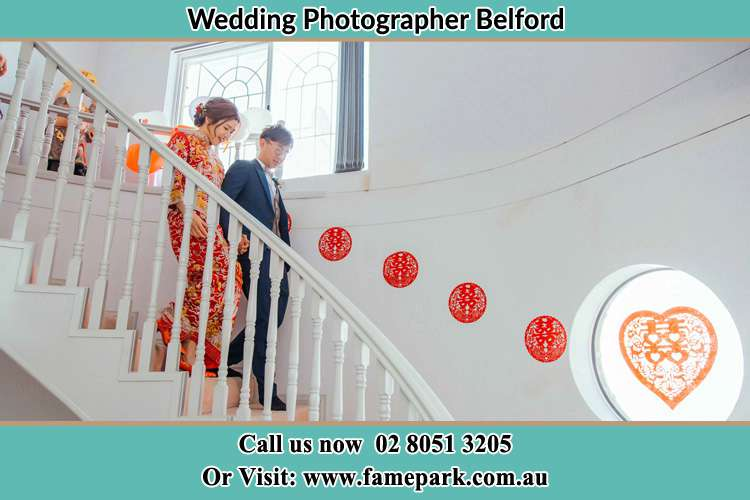 Photo of the Bride and the Groom going down the stair Belford NSW 2335