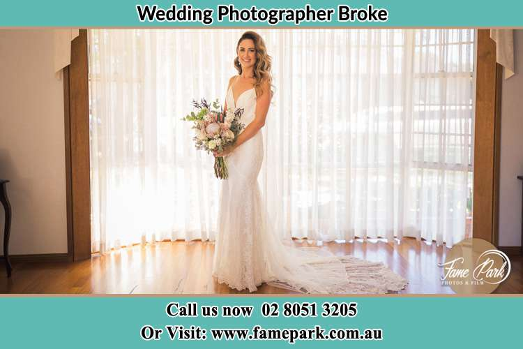Photo of the Bride holding flower bouquet Broke NSW 2330