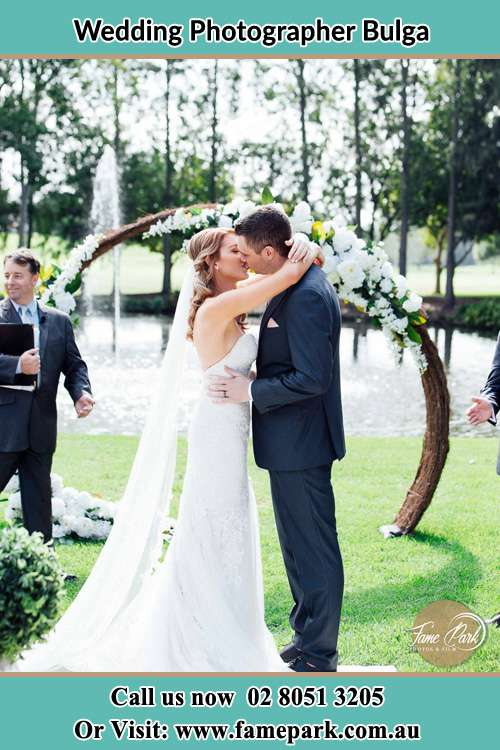 Photo of the Bride and the Groom kissing Bulga NSW 2330