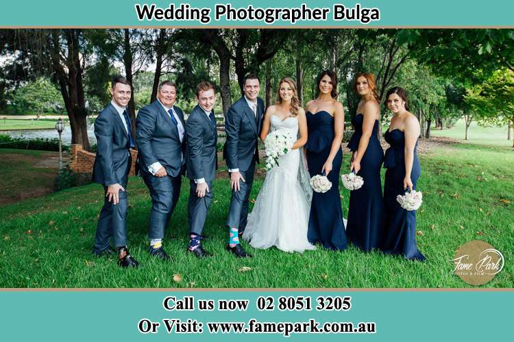 The Bride and the Groom with their entourage pose for the camera Bulga NSW 2330