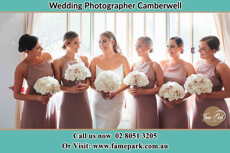 Photo of the Bride and the bridesmaids holding flower bouquet Camberwell NSW 2330