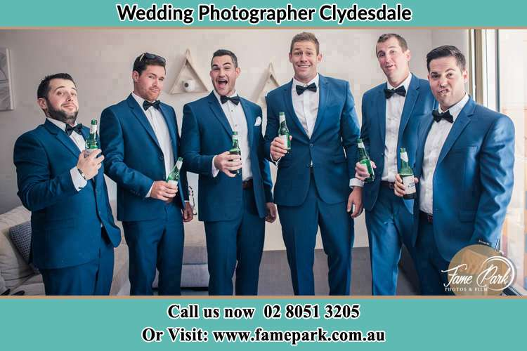 The groom and his groomsmen striking a wacky pose in front of the camera Clydesdale NSW 2330