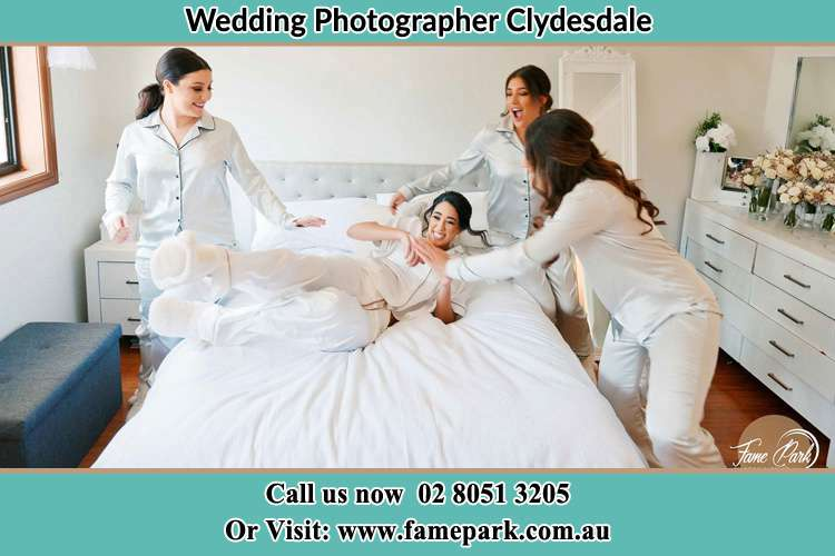 Photo of the Bride and the bridesmaids playing on bed Clydesdale NSW 2330