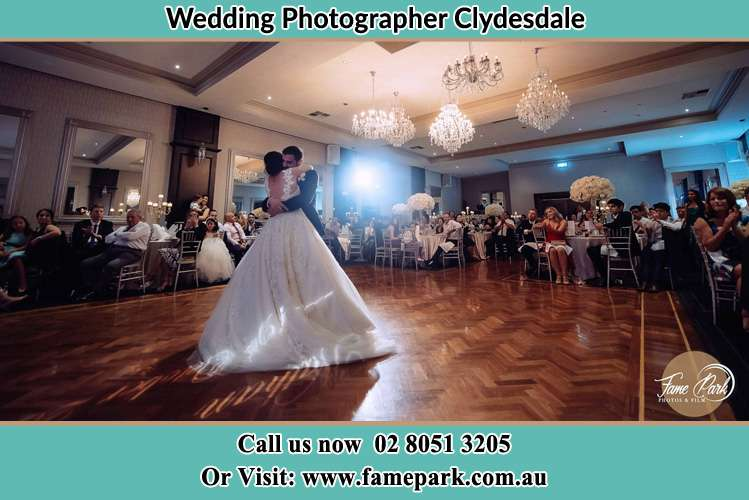 Photo of the Bride and the Groom hugging on the dance floor Clydesdale NSW 2330