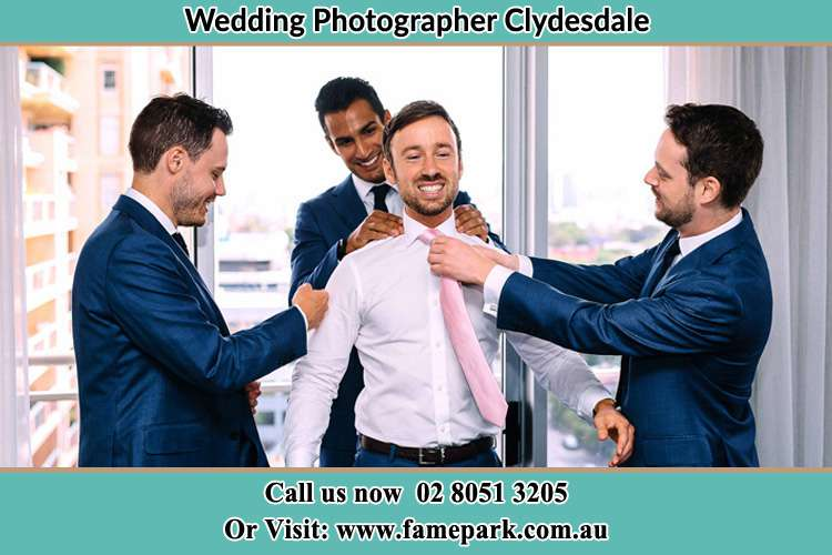 Photo of the Groom helping by the groomsmen getting ready Clydesdale NSW 2330
