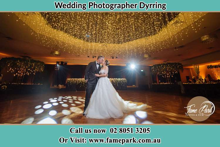 Photo of the Groom and the Bride kissing on the dance floor Dyrring NSW 2330