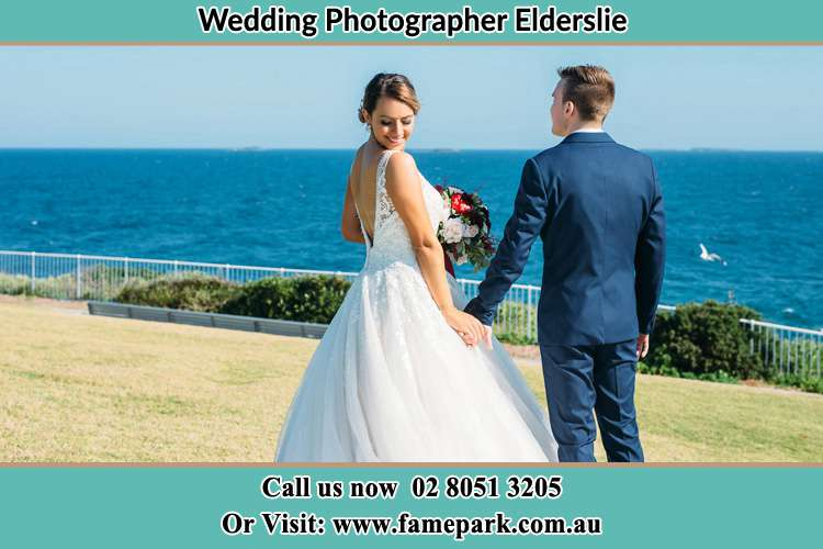Photo of the Bride and the Groom holding at the yard Elderslie NSW 2570