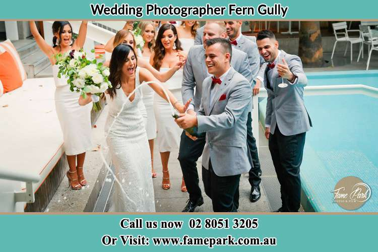 Photo of the Groom and the Bride celebrating with the secondary sponsors Fern Gully NSW 2330