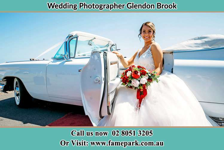 Photo of the Bride outside the bridal car Glendon Brook NSW 2330