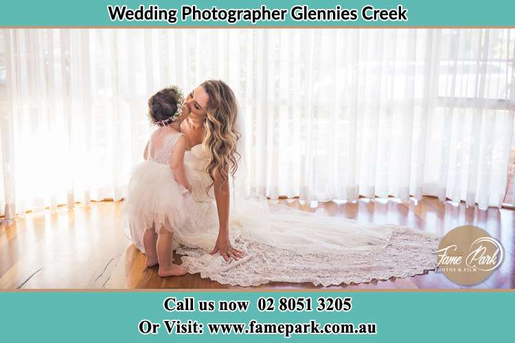 Photo of the Bride kiss the flower girl Glennies Creek NSW 2330