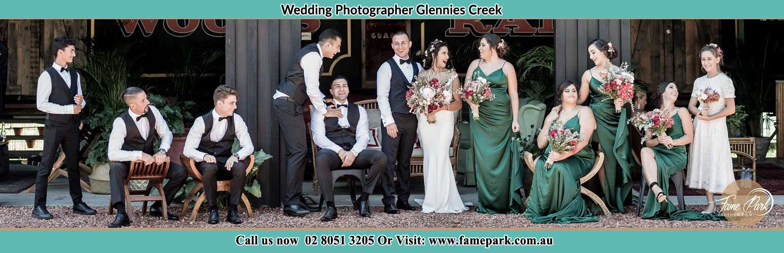 The Bride and the Groom with their entourage pose for the camera Glennies Creek NSW 2330