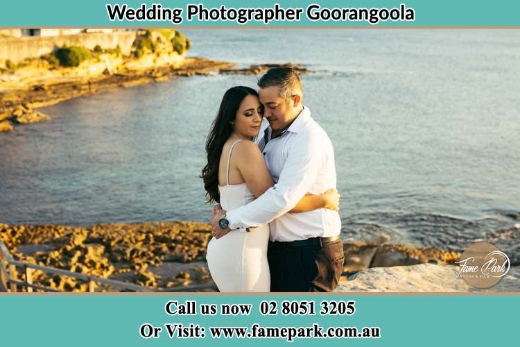 Photo of the Bride and the Groom hugging near the lake Goorangoola NSW 2330