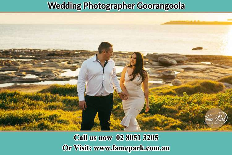 Photo of the Groom and the Bride walking near the lake Goorangoola NSW 2330