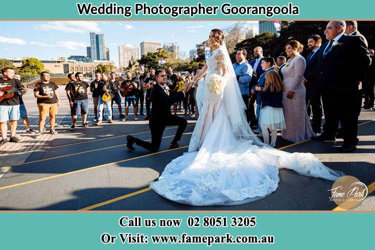 Groom Kneeling down in front of the Bride Goorangoola NSW 2330