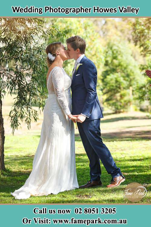 Photo of the Bride and the Groom kissing at the yard Howes Valley NSW 2330