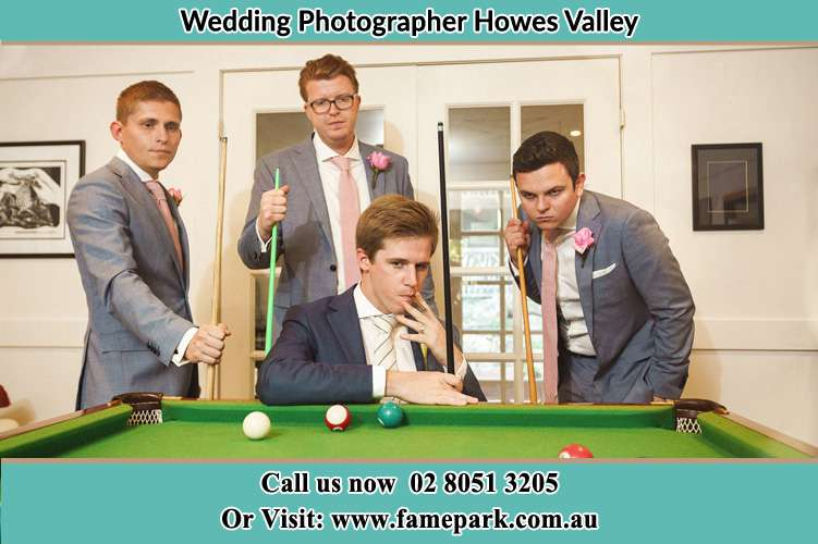 Photo of the Groom and the groomsmen playing billiard Howes Valley NSW 2330