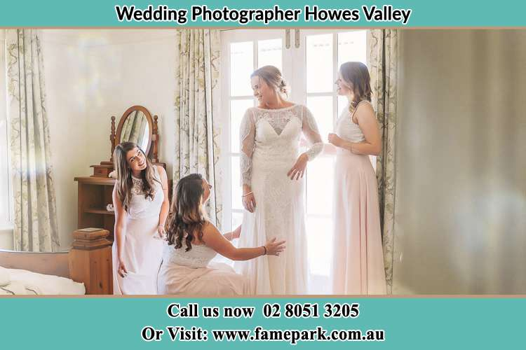 Photo of the Bride and the secondary sponsor preparing Howes Valley NSW 2330