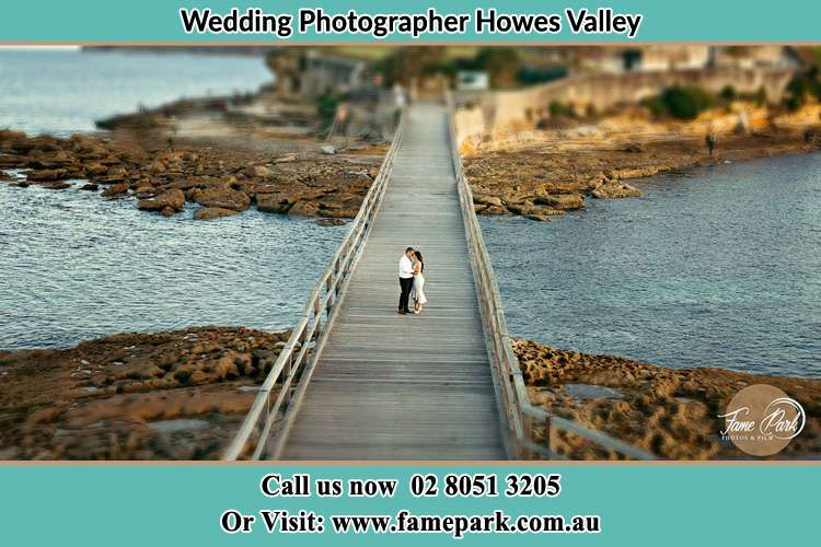 Photo of the Groom and the Bride at the bridge Howes Valley NSW 2330
