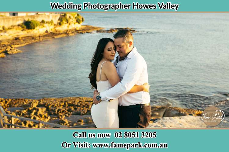 Photo of the Bride and the Groom hugging near the lake Howes Valley NSW 2330