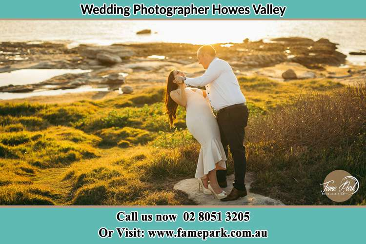 Photo of the Bride and the Groom dancing near the lake Howes Valley NSW 2330