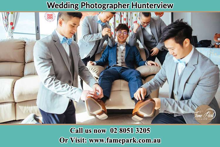 Photo of the Groom helping by the groomsmen getting ready Hunterview NSW 2330