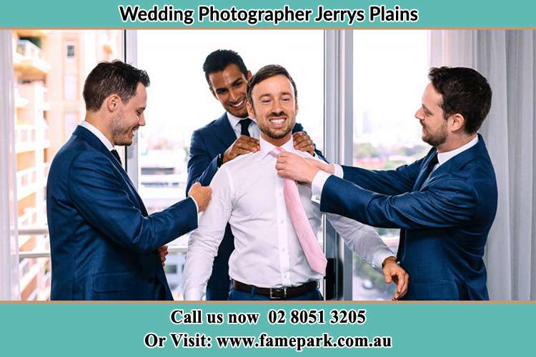 Photo of the Groom helping by the groomsmen getting ready Jerrys Plains NSW 2330