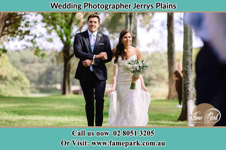 Photo of the Groom and the Bride walking Jerrys Plains NSW 2330