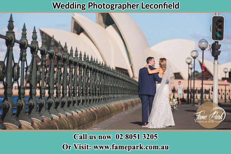 The Groom and the Bride walking towards the Sydney Grand Opera House Leconfield NSW 2335