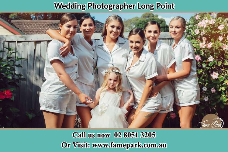 Photo of the Bride and the bridesmaids with the flower girl Long Point NSW 2564