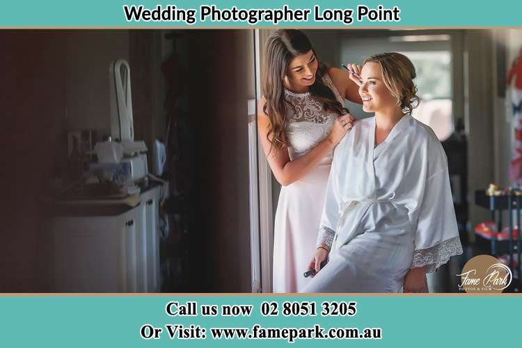 Photo of the Bride having make up Long Point NSW 2564