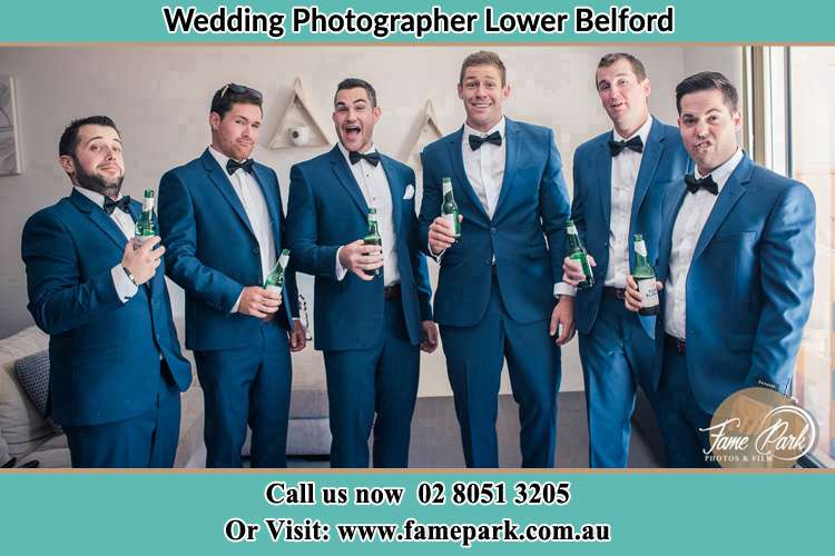 The groom and his groomsmen striking a wacky pose in front of the camera Lower Belford NSW 2335