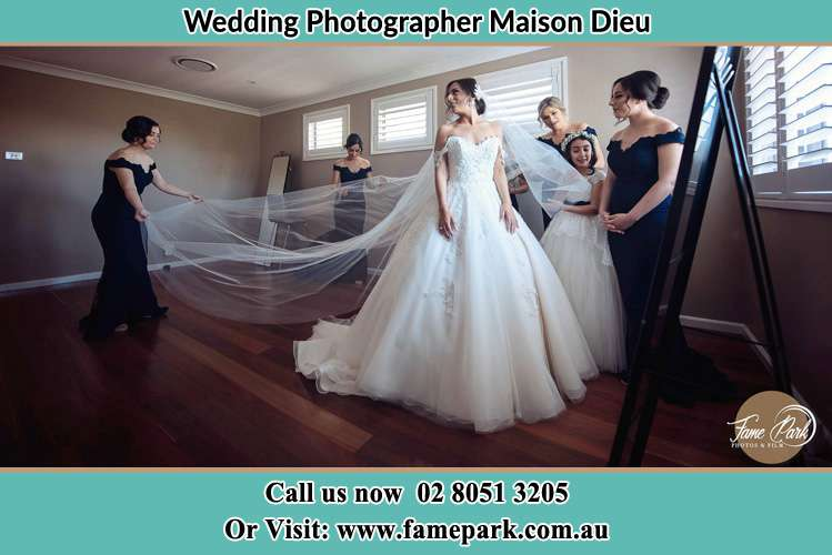 Photo of the Bride and the secondary sponsor preparing Maison Dieu NSW 2330