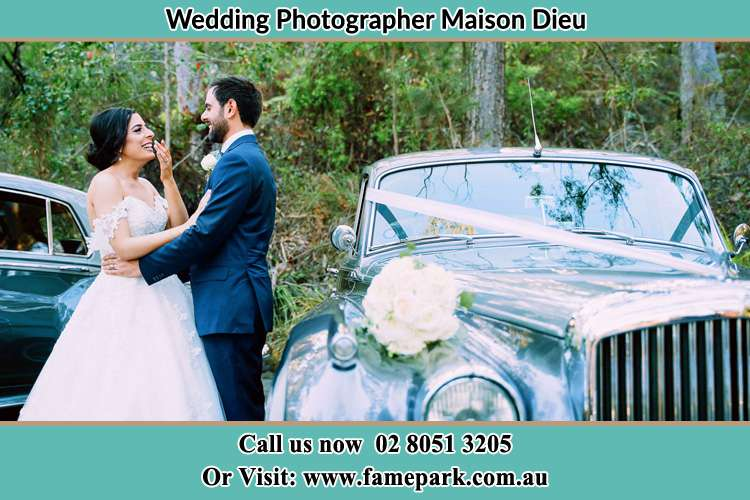 Photo of the Bride and the Groom near the bridal car Maison Dieu NSW 2330