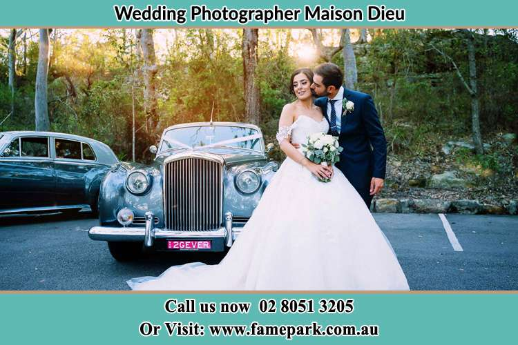 Photo of the Bride and the Groom at the front of the bridal car Maison Dieu NSW 2330