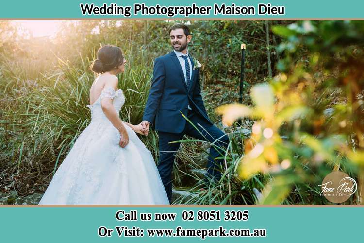 Photo of the Bride and the Groom going up the hill Maison Dieu NSW 2330