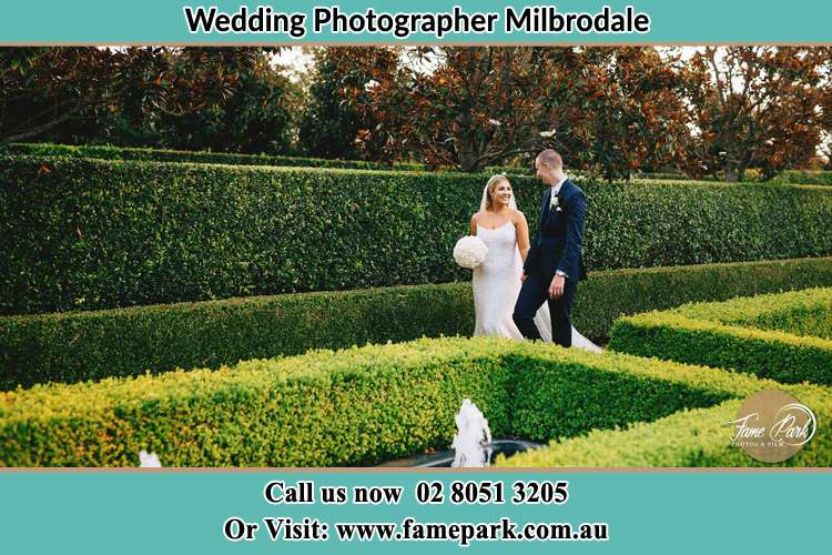 Photo of the Bride and the Groom walking at the garden Milbrodale NSW 2330