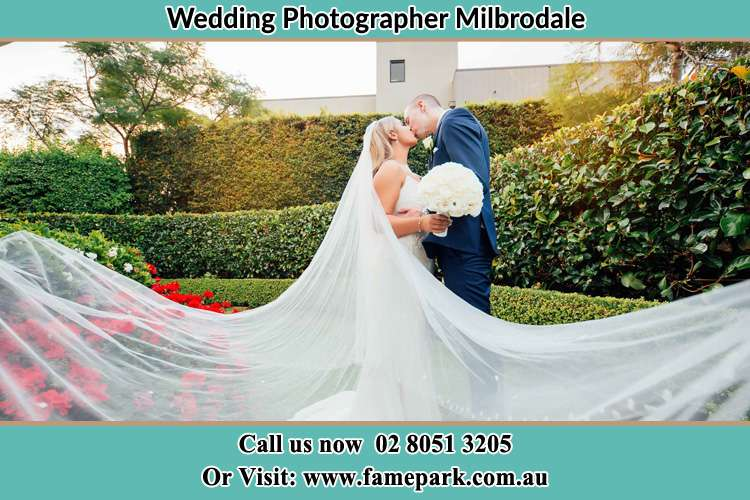 Photo of the Bride and the Groom kissing at the garden Milbrodale NSW 2330