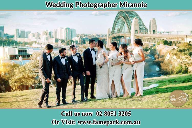 Photo of the Groom and the Bride with the entourage near the bridge Mirannie NSW 2330