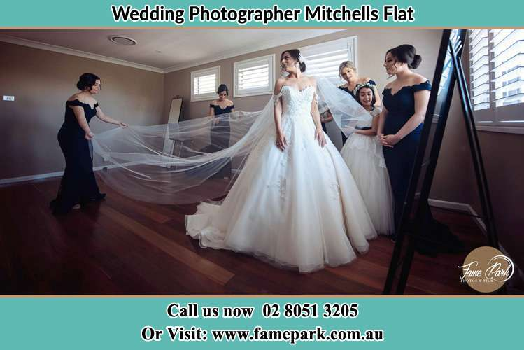 Photo of the Bride and the secondary sponsor preparing Mitchells Flat NSW 2330