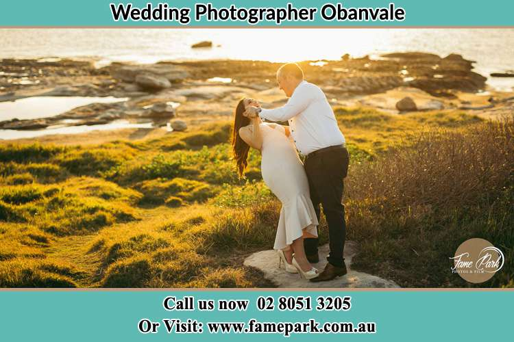 Photo of the Bride and the Groom dancing near the lake Obanvale NSW 2330