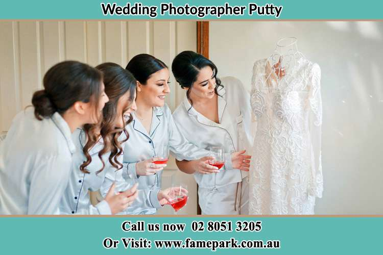 Photo of the Bride and the bridesmaids checking the wedding gown Putty NSW 2330