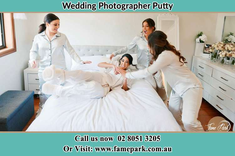 Photo of the Bride and the bridesmaids playing on bed Putty NSW 2330