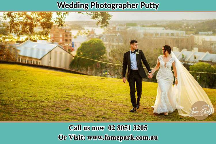 Photo of the Groom and the Bride holding hands while walking Putty NSW 2330