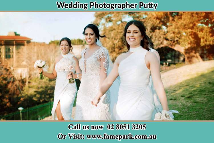 Photo of the Bride and the bridesmaids walking Putty NSW 2330