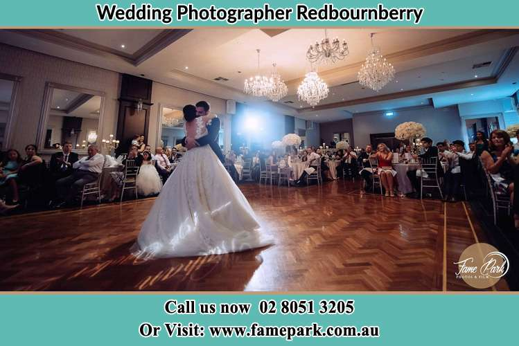 Photo of the Bride and the Groom hugging on the dance floor Redbournberry NSW 2330