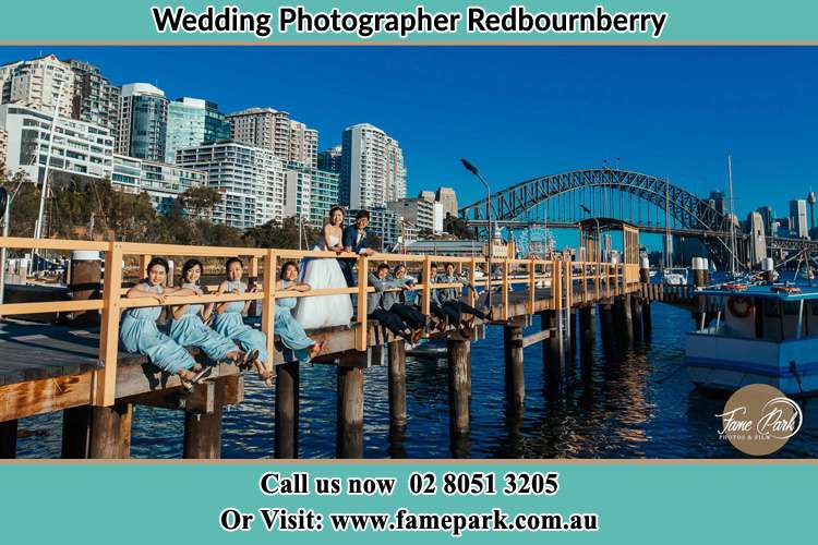 Photo of the Groom and the Bride with the entourage at the bridge Redbournberry NSW 2330